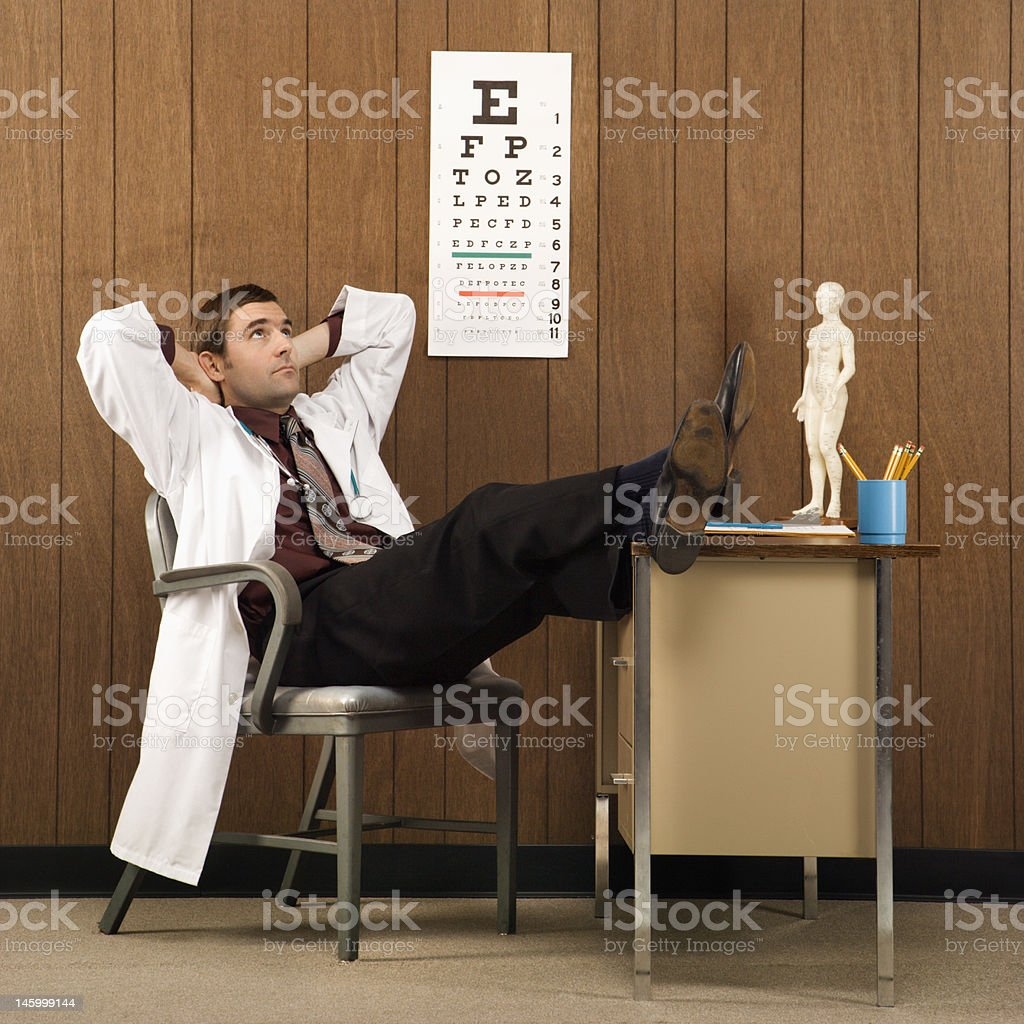 Doctor daydreaming. stock photo