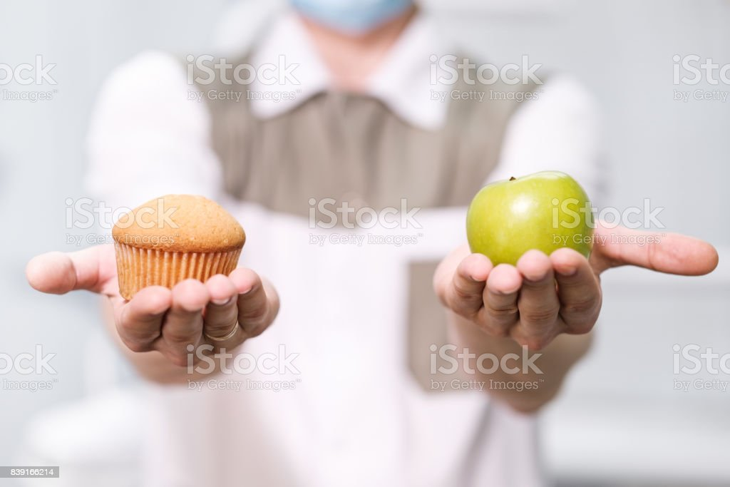 Doctor dentist man speaks about healthy nutrition and dental health stock photo