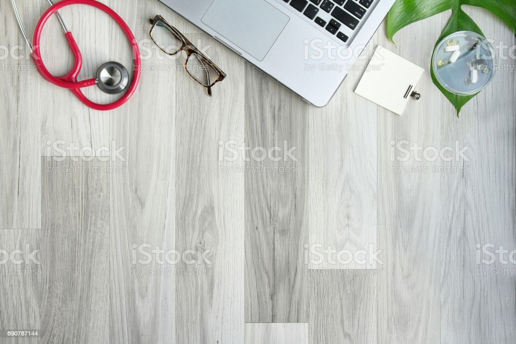 Doctor Desk Table With Stethoscope Laptop Computer And Eyeglasses Top View  With Copy Space Flat Lay Stock Photo - Download Image Now
