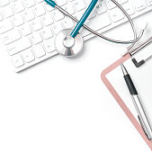 istock Doctor diagnoses concept - stethoscope on computer keyboard with medical record case and pen on white working table. Top view, flat lay, copy space 1170696975