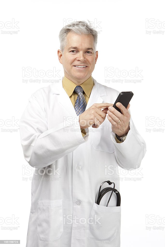 Doctor dictating with Smart Phone stock photo