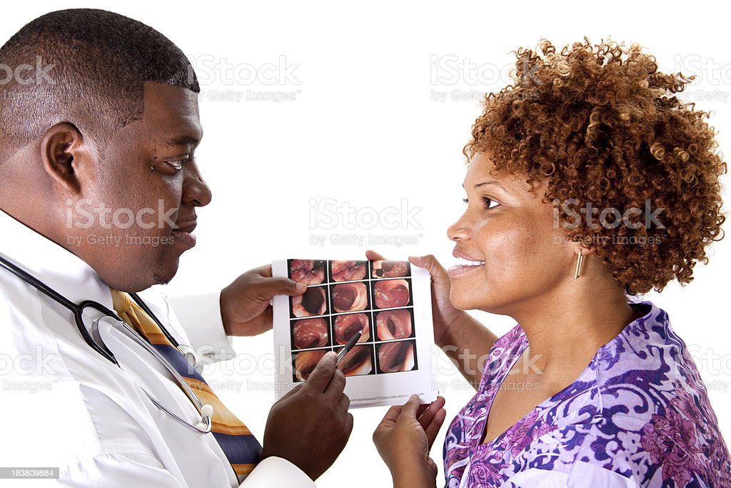 Doctor discussing colonoscopy report with patient. stock photo