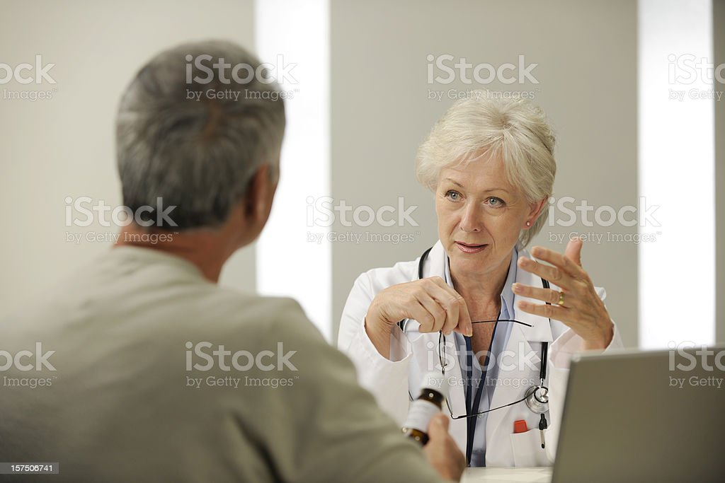 Doctor discussing medication with patient. royalty-free stock photo