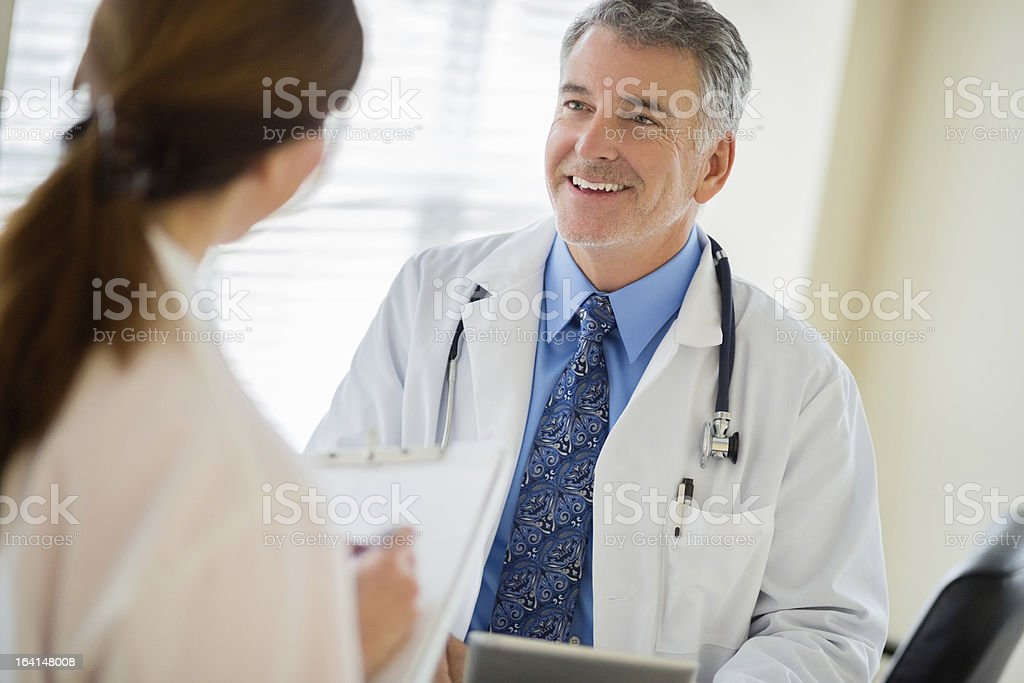 Doctor Discussing With Female Colleague royalty-free stock photo