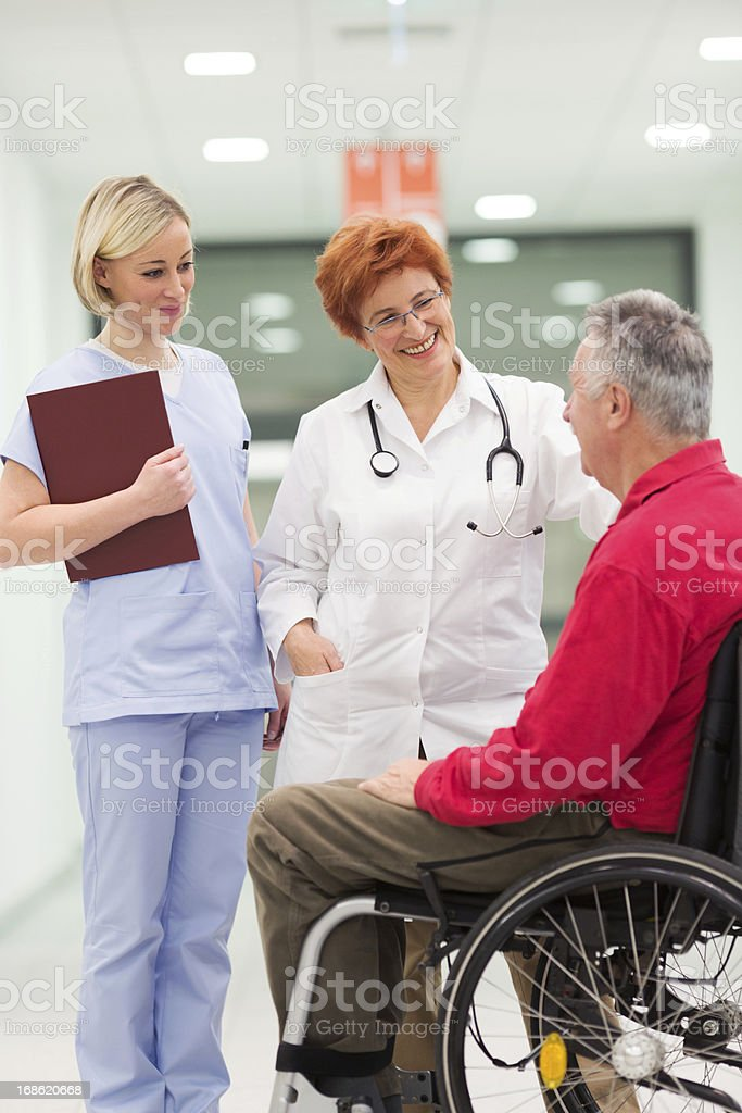 Doctor discussing with patient royalty-free stock photo
