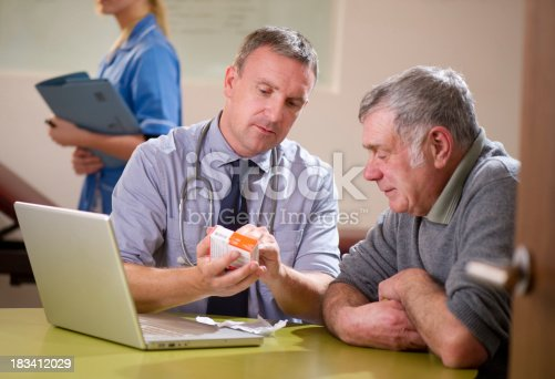 istock Doctor discussing with patient 183412029