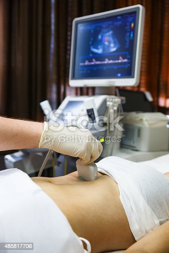 istock Doctor doing an ultrasound on a patient abdomen 485817706
