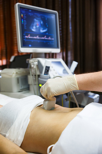 istock Doctor doing an ultrasound on a patient abdomen 639108734
