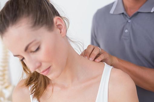 istock Doctor doing neck adjustment 667156296