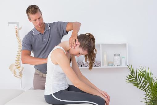 istock Doctor doing neck adjustment 667156392