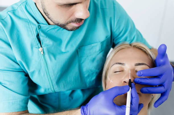 Doctor doing preparations for botox on female patient stock photo