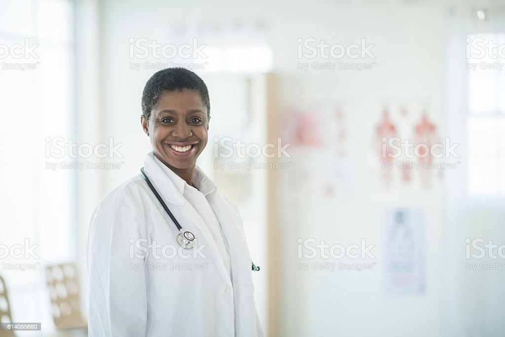 Doctor Doing Rounds in a Clinic stock photo