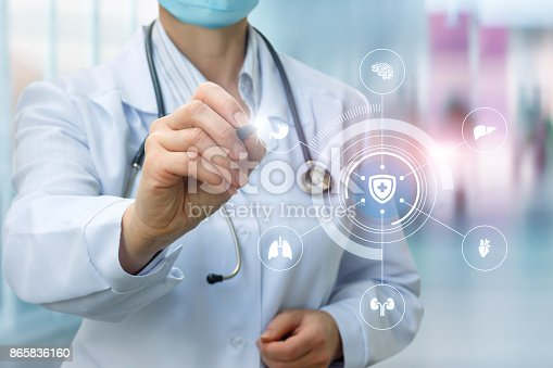 istock Doctor draws a structure for protecting the internal organs of a person . 865836160