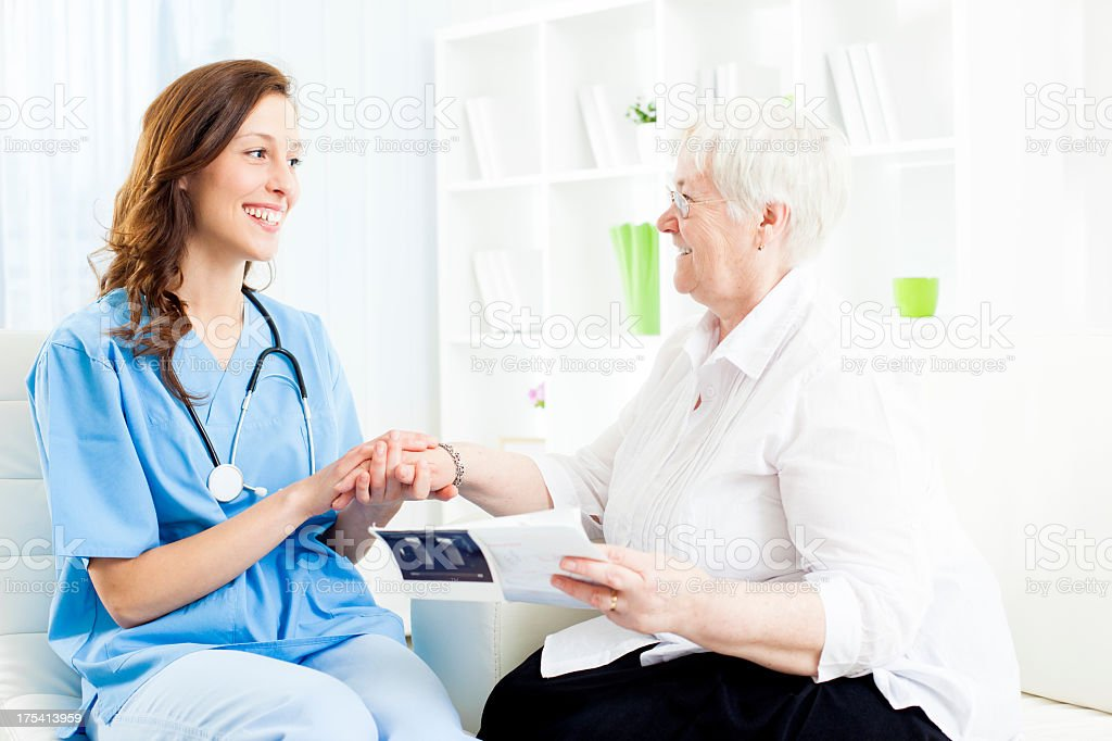 Doctor Encourage senior woman patient. royalty-free stock photo