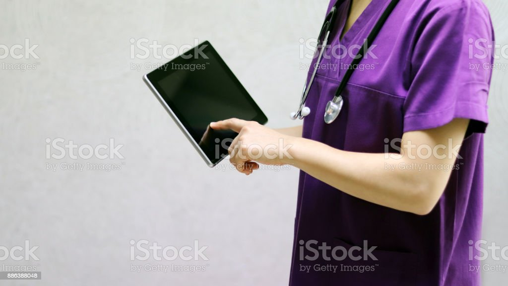A doctor examines his patient with a stethoscope. stock photo