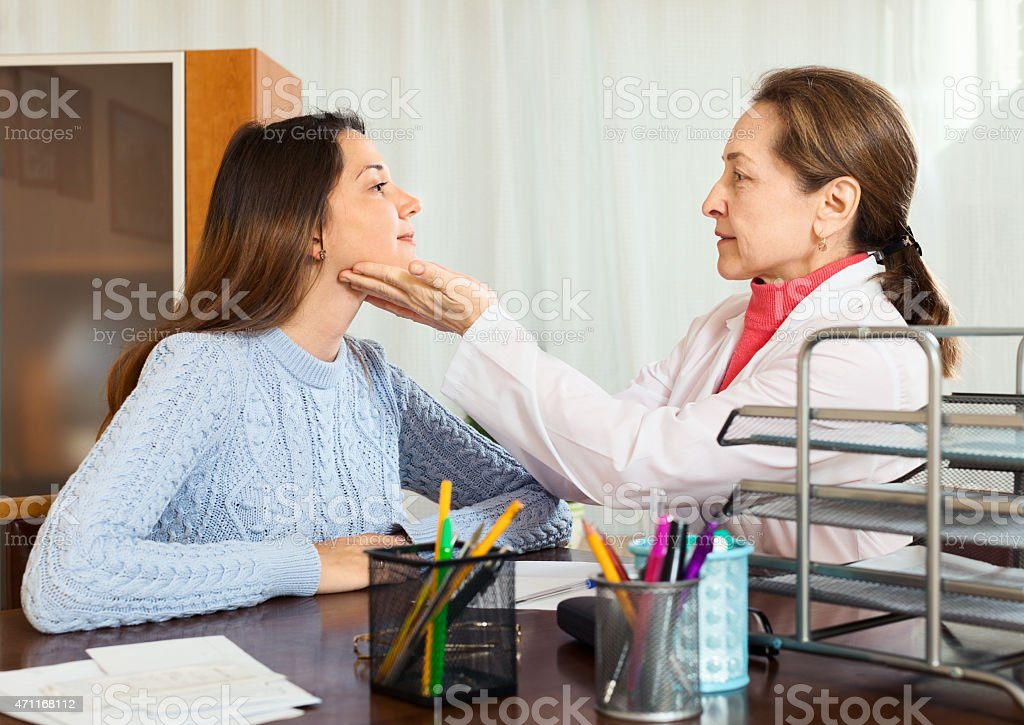 Doctor examines young girl stock photo