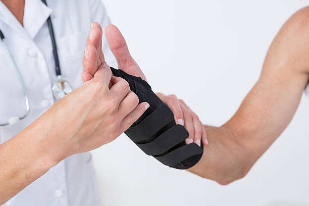 Doctor examining a man wrist stock photo