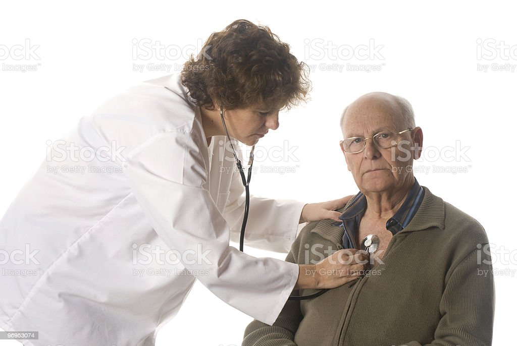 Doctor examining a patient royalty-free stock photo