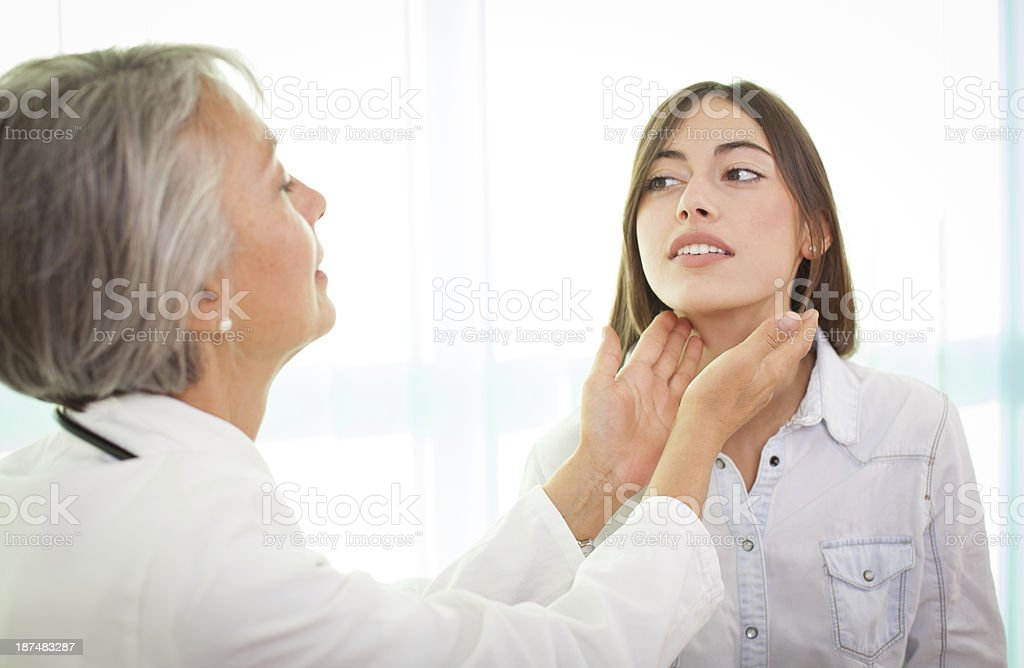 A doctor examining a woman patient stock photo