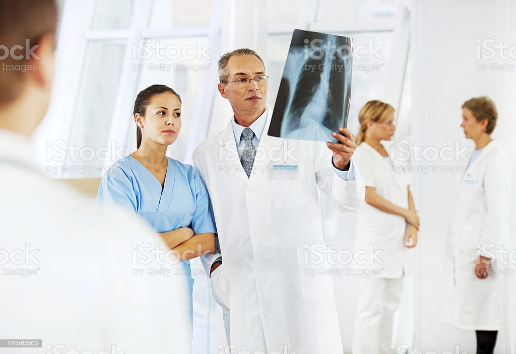 Doctor examining an x-ray image. royalty-free stock photo