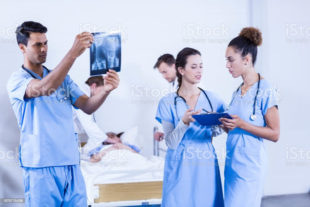 Doctor examining an x-ray in hospital royalty-free stock photo