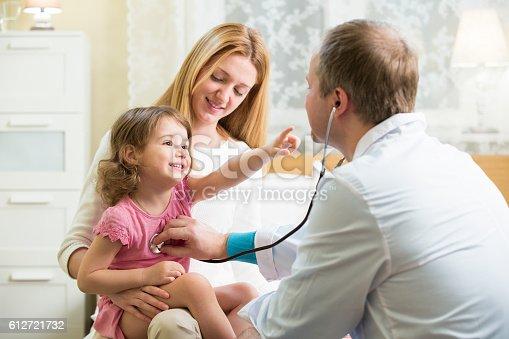 istock Doctor examining child 612721732
