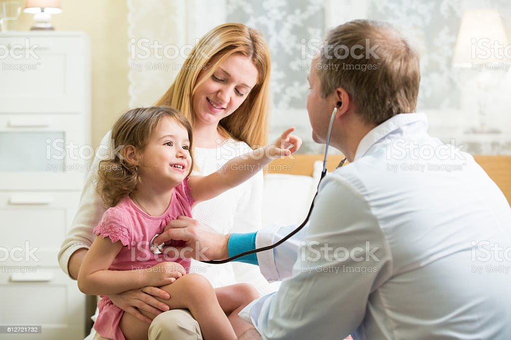Doctor examining child stock photo