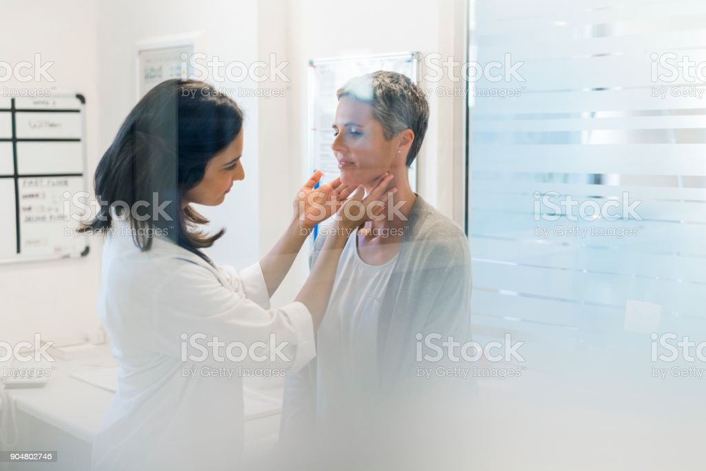 Doctor examining female patient fat hospital stock photo