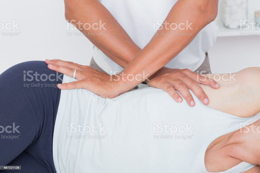 Doctor examining his patient pelvis stock photo