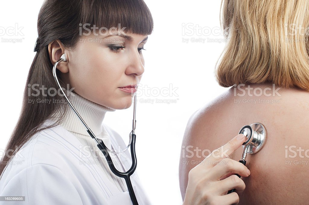 Doctor examining lungs of a patient stock photo