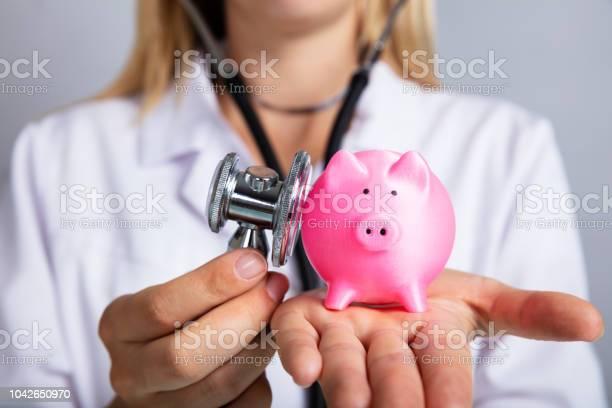 Doctor examining piggybank with stethoscope picture id1042650970?b=1&k=6&m=1042650970&s=612x612&h=n4kkzvz avmnmg hrr4 muufhg08lnc5zrobu7mxmxe=