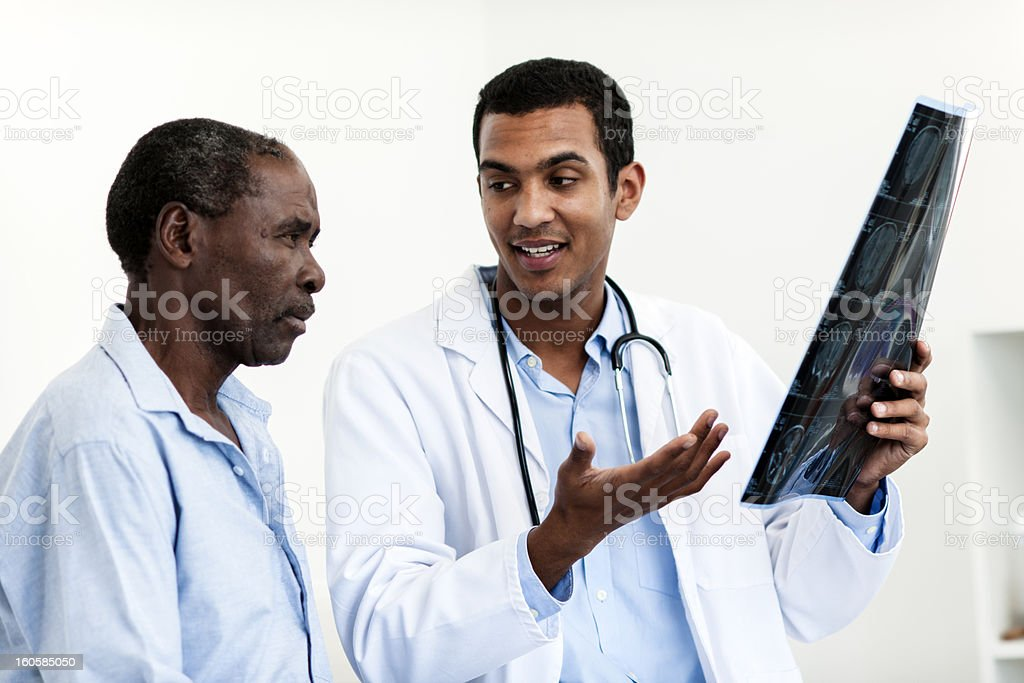 Doctor examining scans royalty-free stock photo