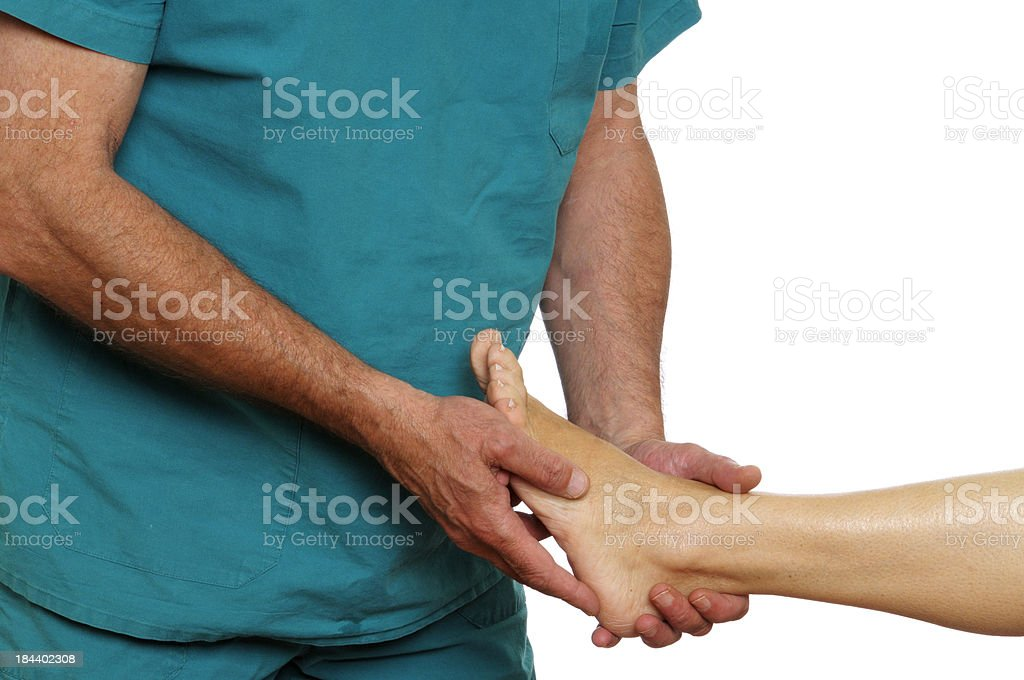 Doctor Examining Woman Foot stock photo