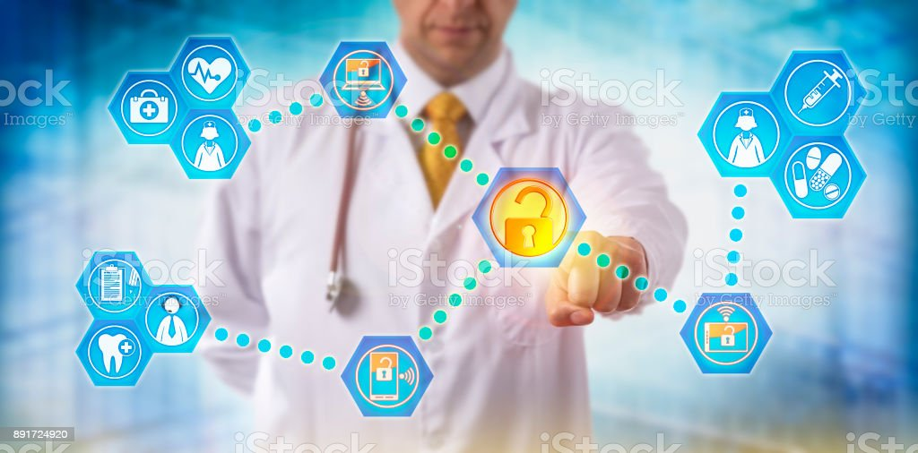 Doctor Exchanging Health Information With Staff stock photo