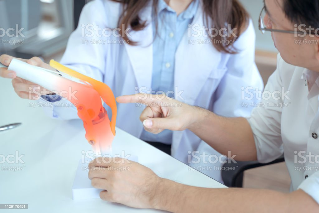 Doctor Explain Knee Pain Stock Photo - Download Image Now