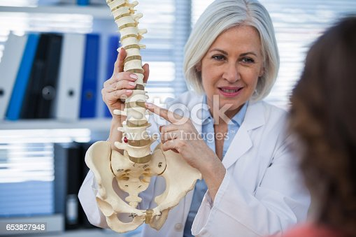 istock Doctor explaining anatomical spine to patient 653827948