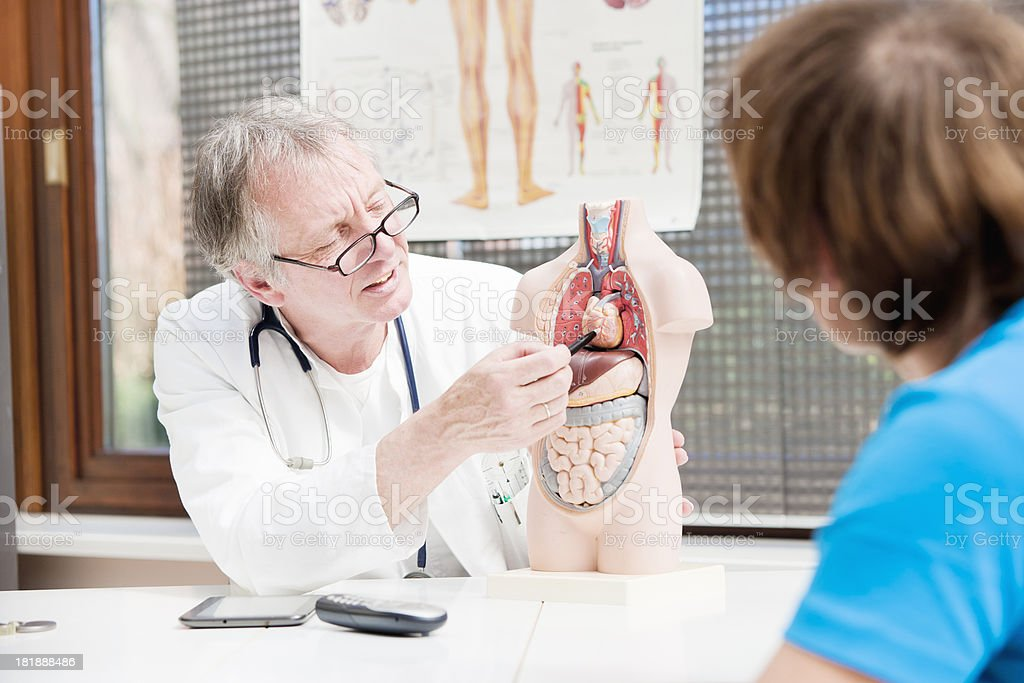 Doctor explaining heart problems royalty-free stock photo