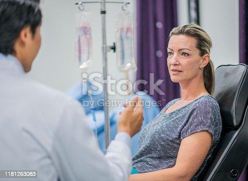 852092658istockphoto Doctor Explaining IV Drip Treatment to Patient stock photo 1181263083