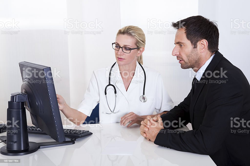 Doctor explaining something to a male patient royalty-free stock photo