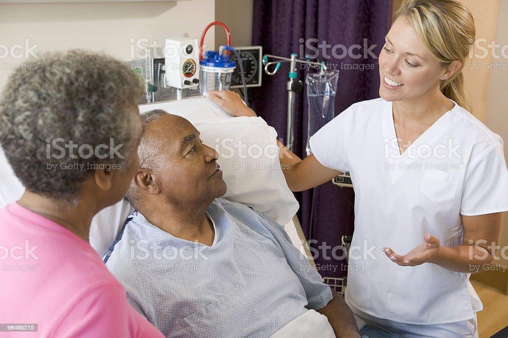 Doctor Explaining To Senior Couple royalty-free stock photo