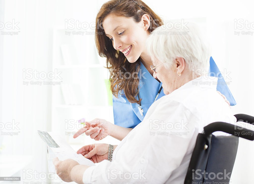 Doctor Explaining Ultrasound Image to senior patient. royalty-free stock photo