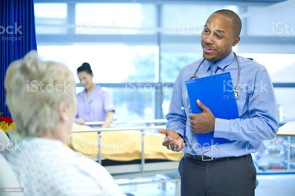 doctor explains stock photo
