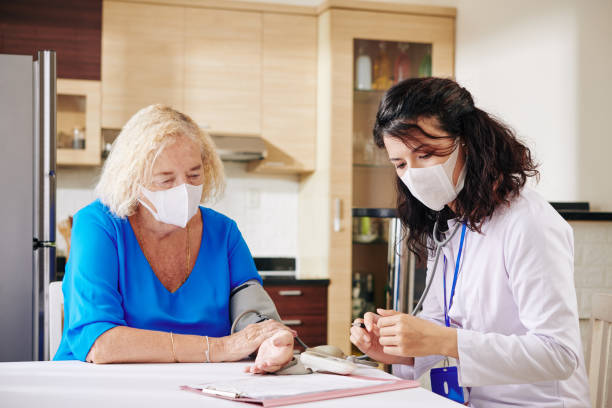 Doctor filling medical history stock photo