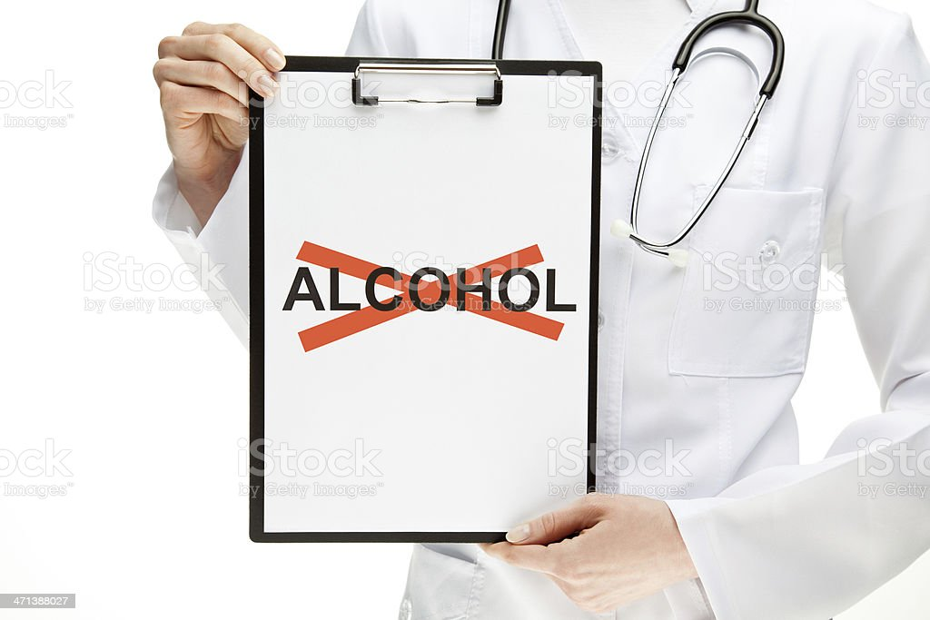 Doctor forbidding alcohol royalty-free stock photo