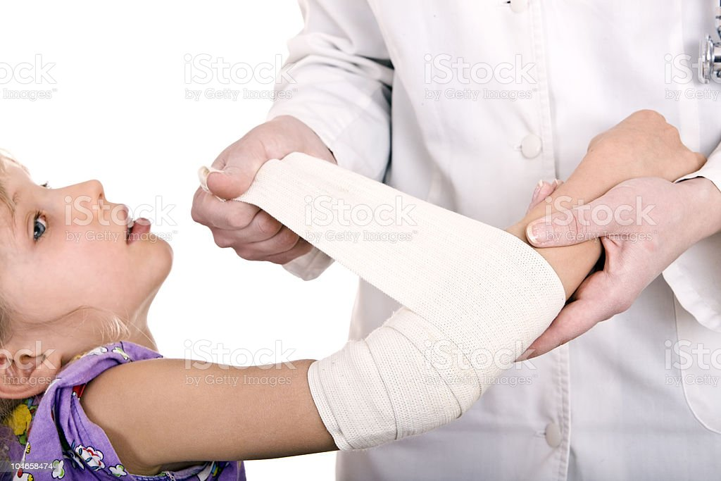 Doctor give first aid of child. royalty-free stock photo
