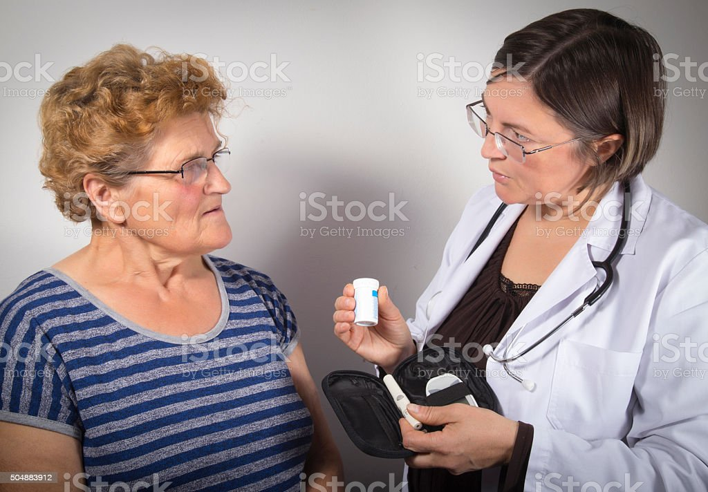 Doctor gives advice on managing diabetes royalty-free stock photo