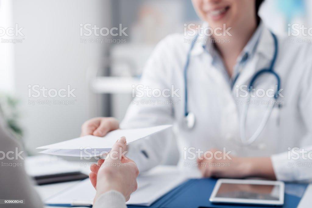 Doctor giving a prescription stock photo