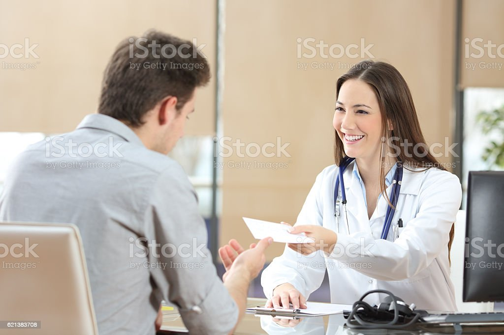 Doctor giving a prescription to her patient stock photo