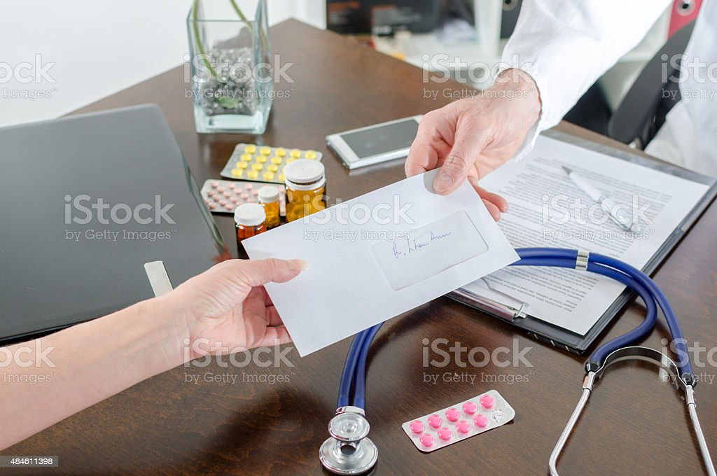 Doctor giving a prescription to his patient stock photo