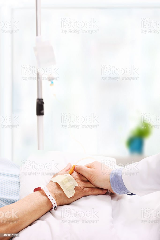 Doctor giving assurance to a patient in a hospital stock photo